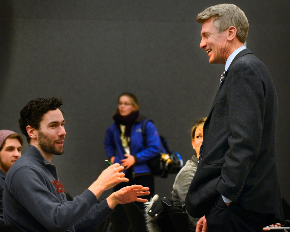 Former Minneapolis mayor RT Rybak greets students before the first lecture of his freshmen seminar, Mayor 101, at Ralph Rapson hall on Monday.