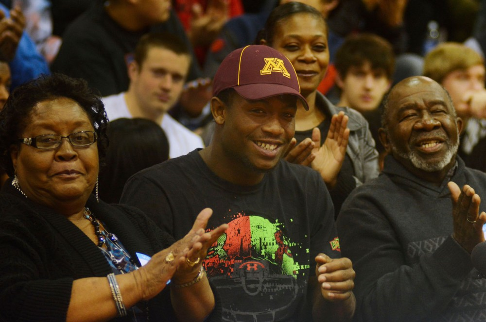 Gophers four-star recruit Jeff Jones celebrates with his grandparents, Doris Jones, left, and Willie Jones, right. Jeff Jones committed to the Gophers on Wednesday morning at Washburn High School.