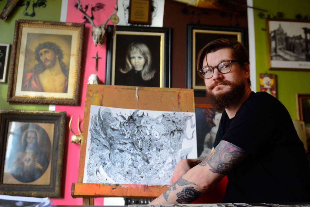 Illustrator Dan Wieken at his studio in St. Paul on Wednesday. Wieken is part of an anti-Valentine's Day art show Saturday at Heart Salon in Northeast Minneapolis.