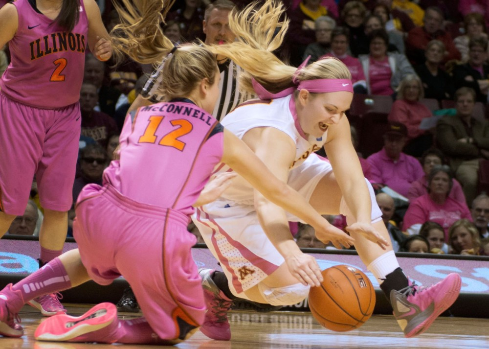 Gophers senior guard Sari Noga dives for a loose ball during the first half of Sunday's game.