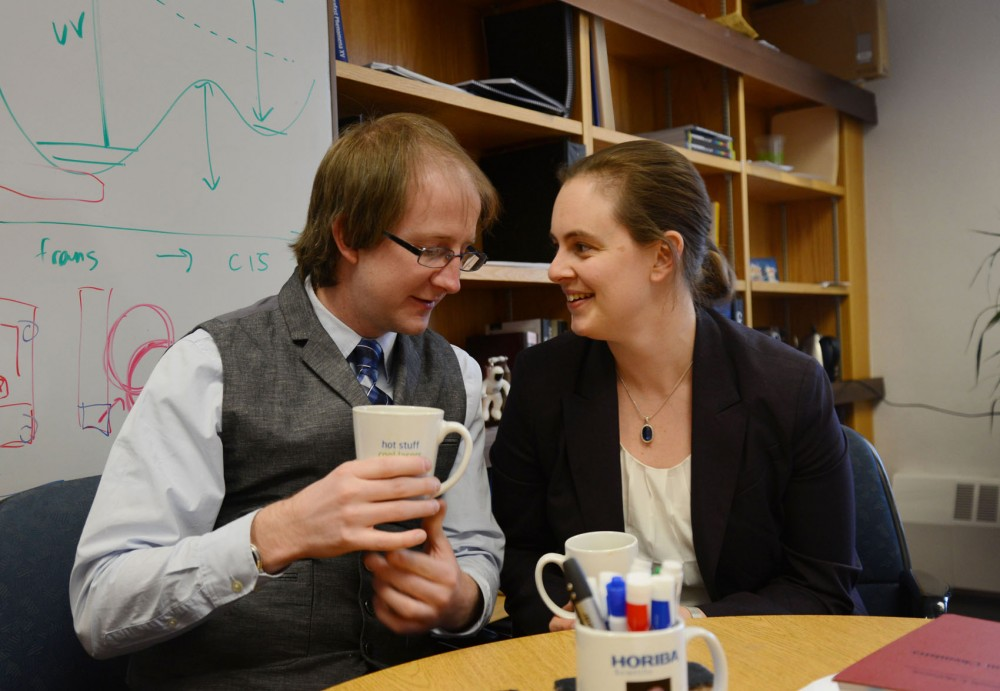 Assistant chemistry professors and couple James Johns and Renee Frontiera talk in Frontiera's office in Appleby Hall on Monday.  Johns and Frontiera met while in grad school and applied to roughly forty-five institutions in hopes of working together.