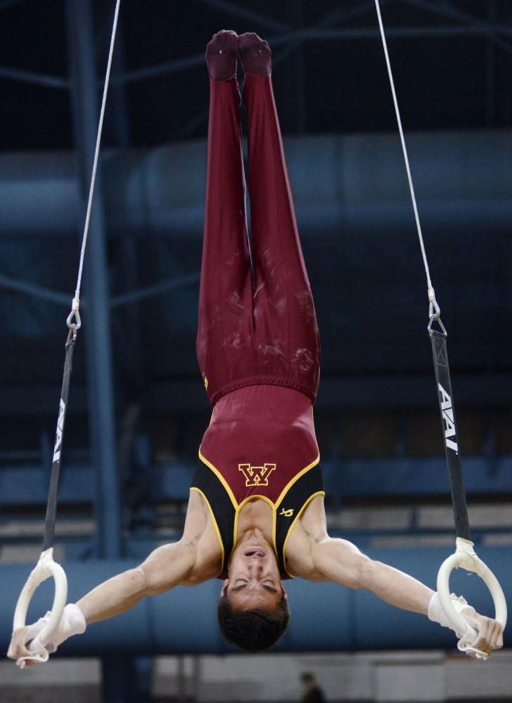 Minnesotas Steve Jaciuk competes on the rings Saturday, Feb. 2, 2013, at the Sports Pavilion.