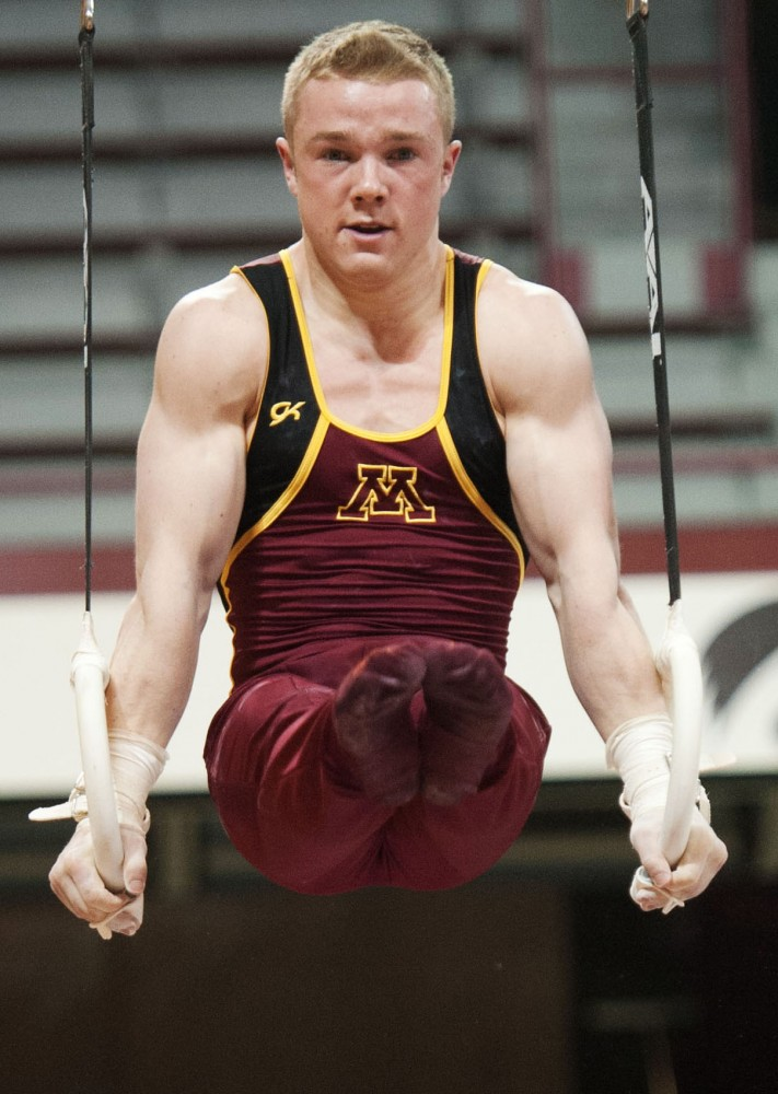 Minnesota's Sean Bauer competes on the rings Saturday, March 24, 2012, at the Sports Pavilion. Bauer competed in the NCAA championships as a freshman in the 2012 season.