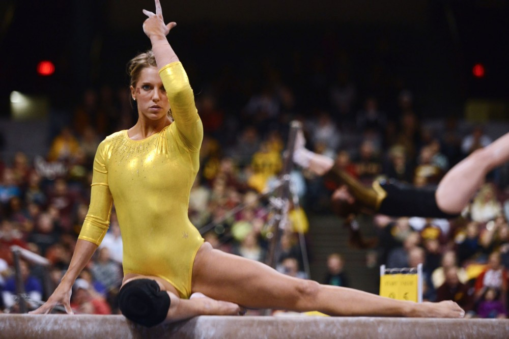 Minnesota's Kylie Schermann executes her beam routine Saturday, Feb. 16, 2013, at the Sports Pavilion.