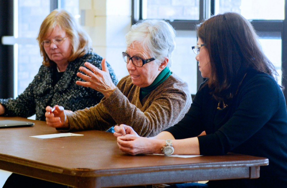 State Representative Phyllis Kahn, center, hosts a town hall meeting to engage with constituents at the Van Cleve Park and Recreation Center on Saturday. Representative Diane Loeffler, left, and Senator Kari Dziedzic, right, joined her in a discussion with community members.