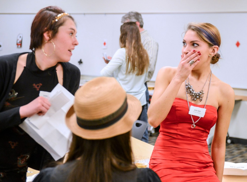 Anna Barton and Kristen Draper gather information and evidence during the Forensic Club's casino themed Murder Mystery dinner in Moos Tower on Friday.