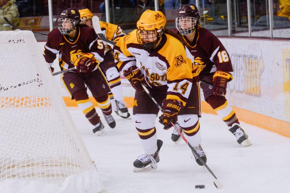 Forward Maryanne Menefee brings the puck around Duluth's net, Saturday at Ridder Arena.
