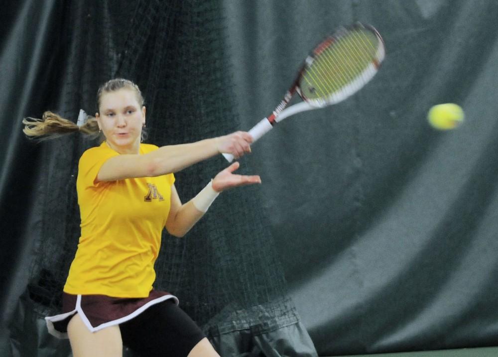 Minnesota senior Natallia Pintusava plays against Marshall, Sunday at the Baseline Tennis Center.
