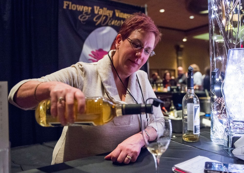 Flower Valley Vineyard and Winery owner Mary Mohn pours a glass of wine for a patron at the Winter Wine Fest, hosted at the Crowne Plaza Hotel in St. Paul on Friday. The Minnesota Grape Growers Association held its 10th Annual Grape and Wine Conference last weekend, where the public could taste wine from Minnesota vineyards.