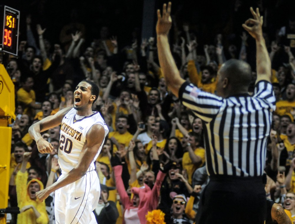 Gophers guard Austin Hollins celebrates after making a three-point shot. Hollins scored a career-high 27 points.