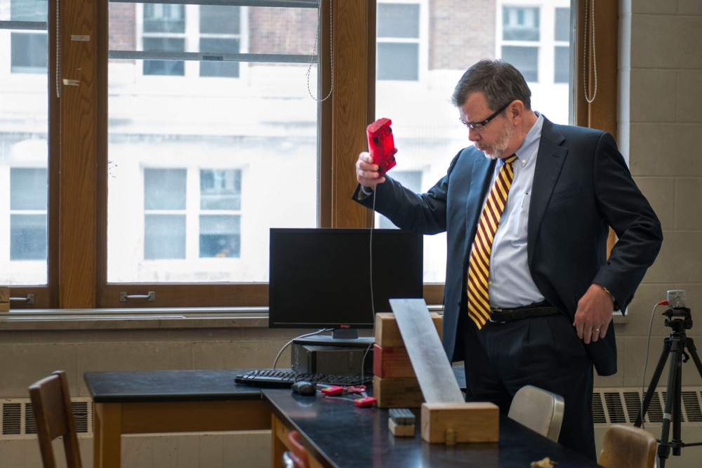 University of Minnesota President Eric Kaler tests out a physics experiment during a media tour of the Tate Laboratory of Physics on Friday morning.