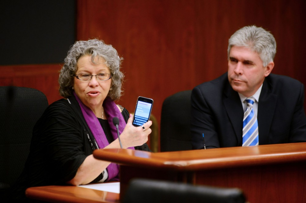Citizen Kate Cavett and Rep. Joe Atkins speak in favor of the kill switch bill at a Labor, Workplace and Regulated Industries committee hearing on the bill on Thursday at the State Office Building. The bill was created in hopes of deterring criminals from profiting off stolen phones, and would render phones useless if taken.