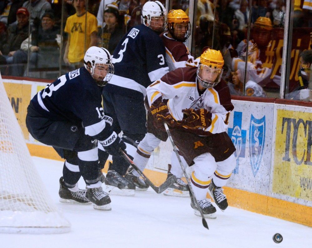 Gopher forward Sam Warning handles the puck against Penn State at Mariucci Arena on Friday.  Minnesota beat Penn State 5-1.