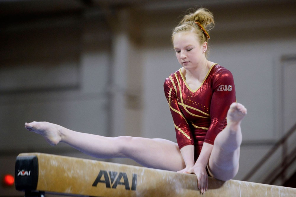 Sophomore Lindsay Mable executes her beam exercise at the Sports Pavilion on Saturday afternoon. Mable had an all-around score of 39.625 to break the school record and the Gophers finished their season with a season-best score of 197.250.