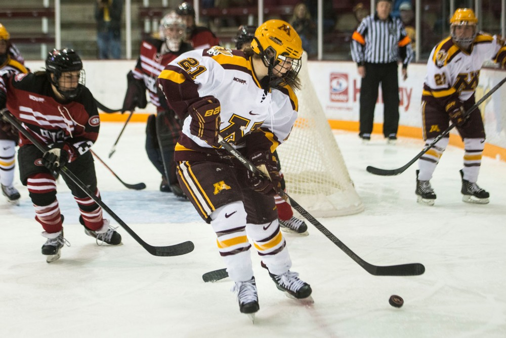 Gophers forward Dani Cameranesi handles the puck during the first period of their game against St. Cloud on Friday evening at Ridder Arena.
