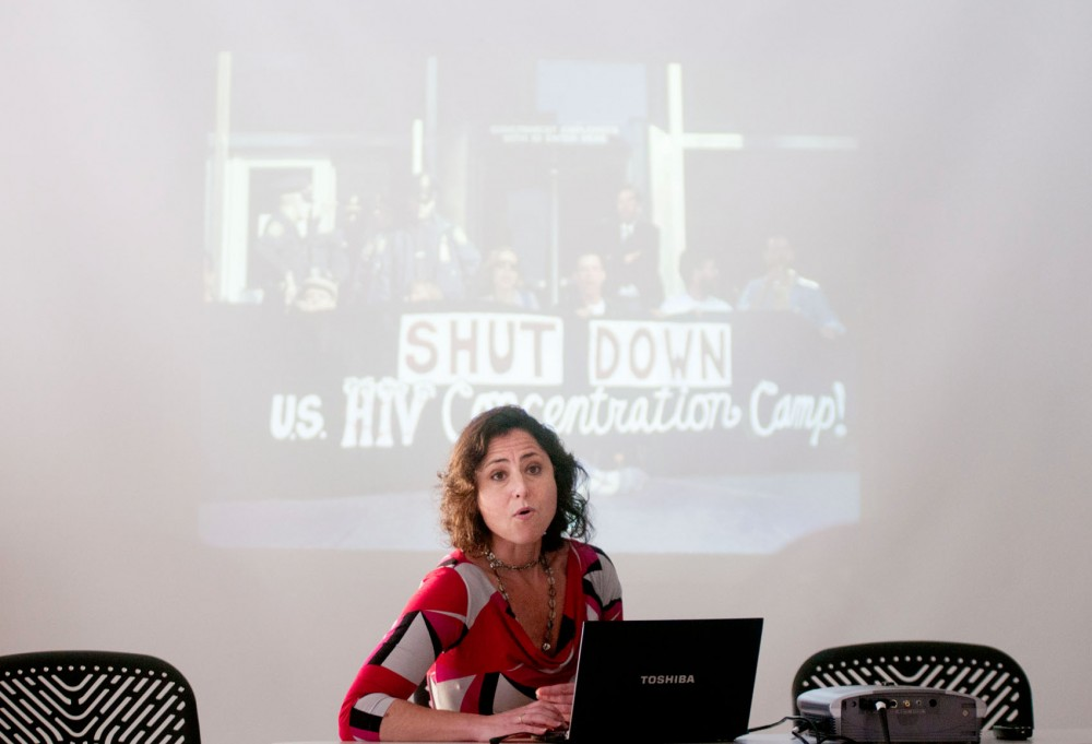 Liz Sevcenko, director of the PhD public history class The Guantanamo Public Memory Project, briefly talks at the Brian Coyle Center in Minneapolis on Saturday evening about past debates concerning whether Guantanamo should remain open.