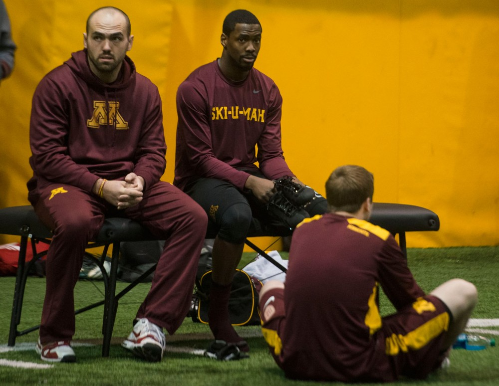 Former Gophers long snapper Jake Filkins, left, and wide receiver Victor Keise rest during Minnesota's Pro Day on Monday, March 3, 2014 at at the Gibson/Nagurski Football Practice Facility.