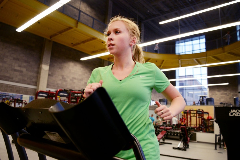 Sophomore Macy Johannsen works out at the University Recreation and Wellness center on Thursday.  Johannsen participated in the Let's Go! Physical Activity Challenge and had the most points out of the girls on her team.