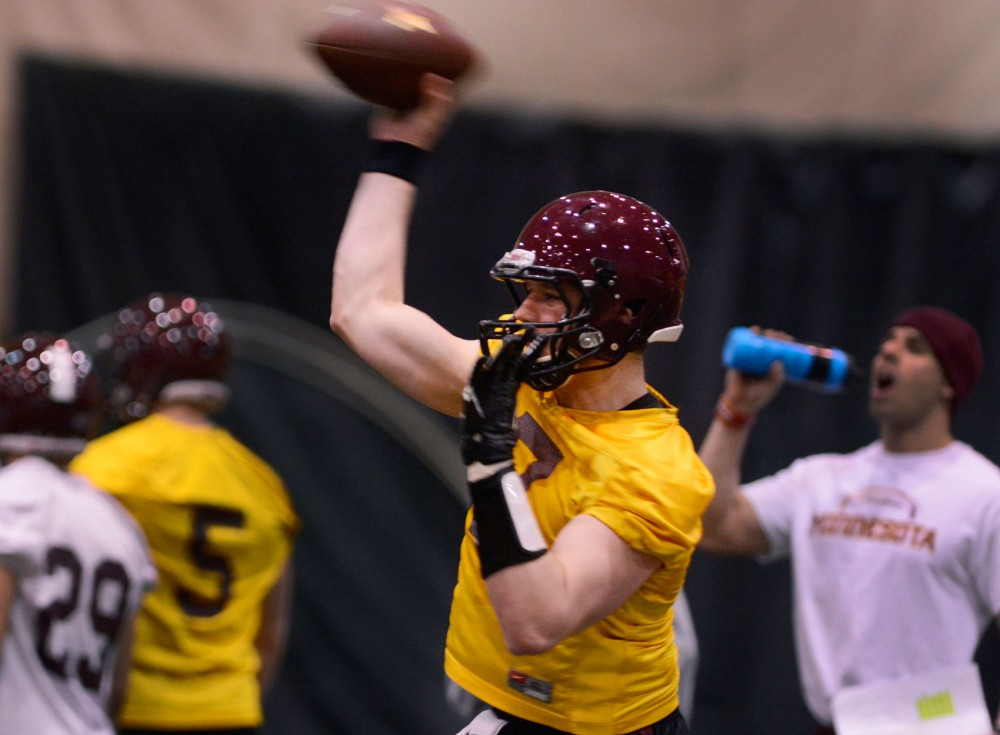 Sophomore starting quarterback Mitch Leidner throws the ball during their practice of spring season at Bierman Field Athletic Building on Tuesday.