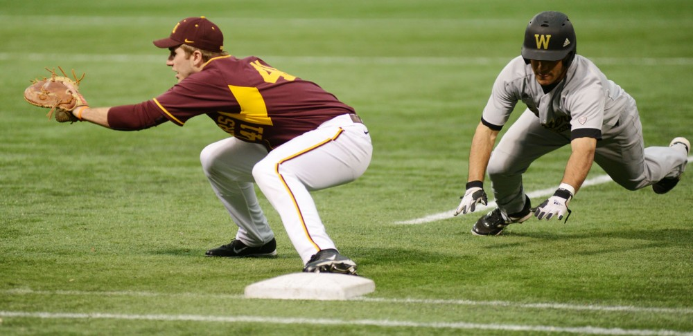 Minnesota first baseman Dan Olinger stretches to catch the ball against Western Michigan on Saturday, Feb. 23, 2013, at the Metrodome.