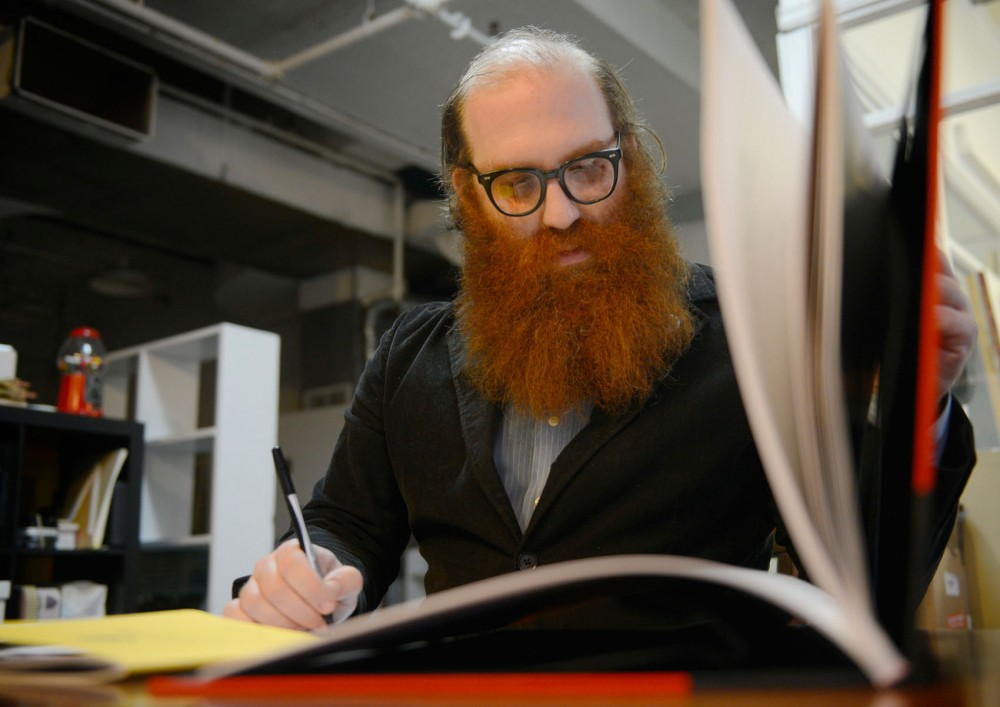 Writer Andy Sturdevant works on an outline for an upcoming essay at his studio in Minneapolis on Tuesday.  Sturdevant will be discussing and reading his first published book
