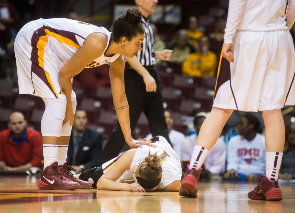 Minnesota guard Rachel Banham lays on the ground after injuring her right leg at the Women's National Invitation Tournament game against Southern Methodist University. Minnesota won 77-70 over SMU to advance to the next game, which will be at South Dakota State on Thursday.