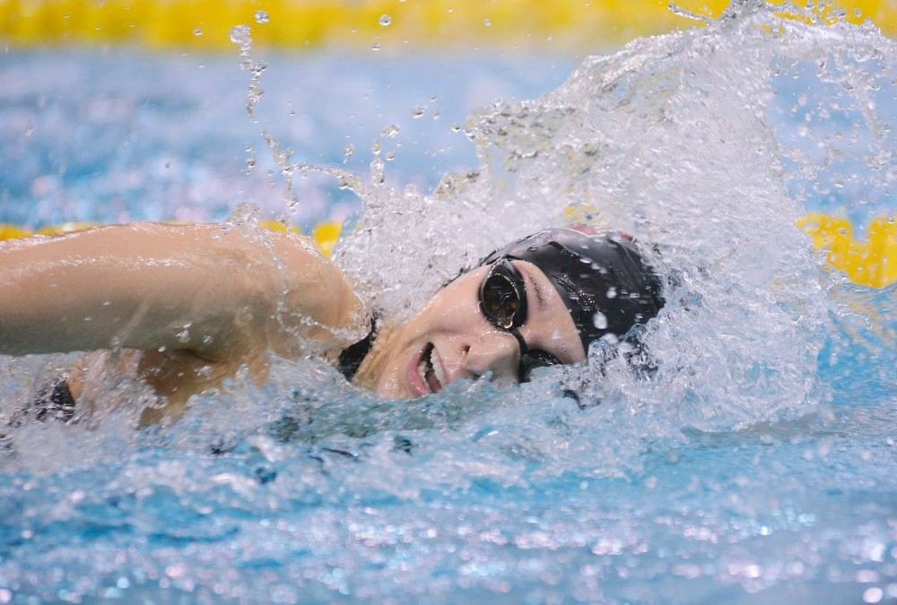 Minnesota junior Jessica Plant swims during the 800 yard freestyle relay during the NCAA Women's Division 1 Championships at the Aquatic Center on Friday.