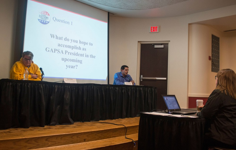 GAPSA presidential candidates Scott Petty, left, and Alfonso Sintjago debate at Coffman Union in the President's Room on Monday night. Petty is the Vice President of University Relations for the Council of Graduate Students and Sintjago is Executive Vice President of GAPSA.