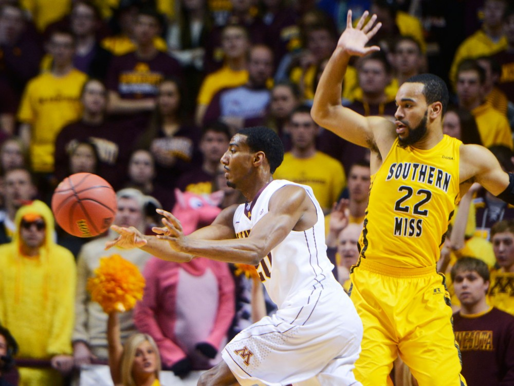 Minnesota guard Austin Hollins passes the ball, Tuesday night at the National Invitation Tournament game against Southern Mississippi at Williams Arena. Gophers won 81-73 and are advancing to the semifinals.