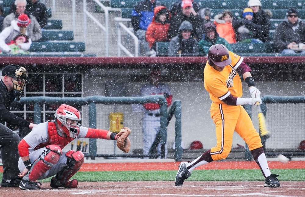 Minnesota shortstop Michael Handel swings at a pitch against Ohio State on Friday, April 5, 2013, at Siebert Field.