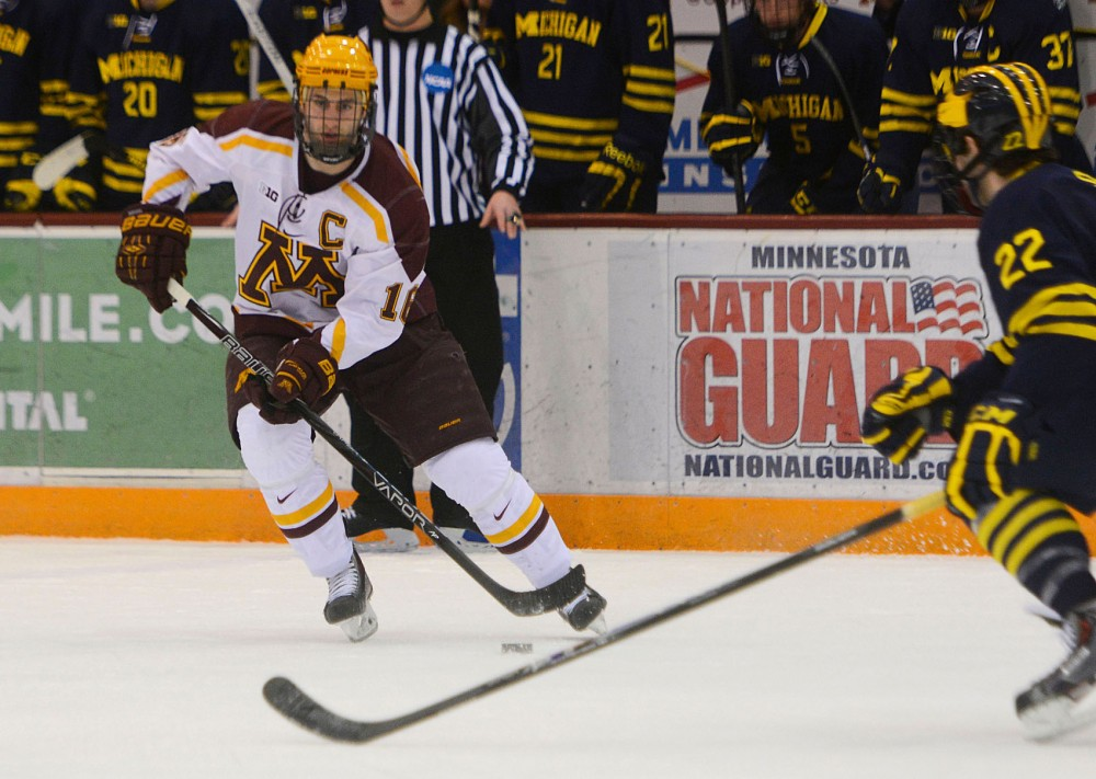Minnesota forward Nate Condon controls the puck against Michigan at Mariucci on Friday, February, 14, 2015.
