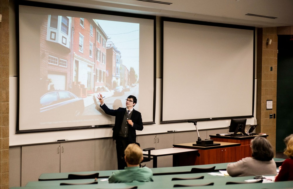 Ph.D. assistant professor and director of heritage conservation and preservation Greg Donofrio presents information about conservation districts at the Center for Urban and Regional Affairs Housing Forum at Carlson on Friday. This forum provided the community with information about how conservation districts could be used in Minnesota to guide development while preserving distinct neighborhood characteristics.