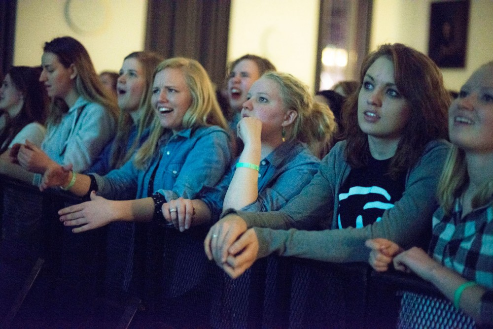 Students react after hearing Mac Miller announced as a headliner for upcoming Spring Jam at Coffman Union on Saturday.