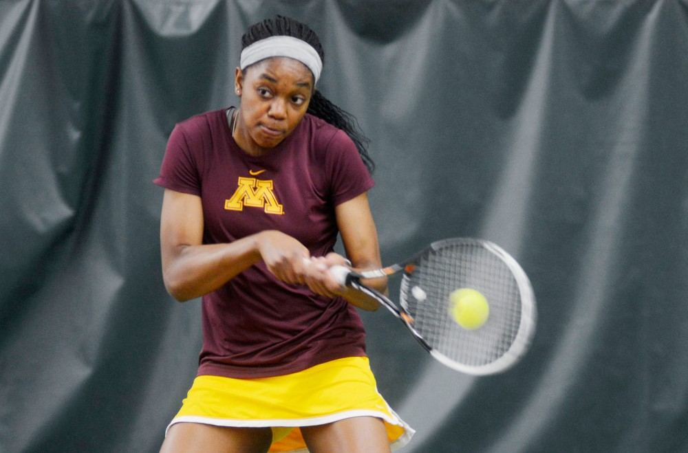 Minnesota sophomore Jessika Mozia returns the ball to Purdue on Friday at Baseline Tennis center. This match ended in a loss of 3-4 by Minnesota.