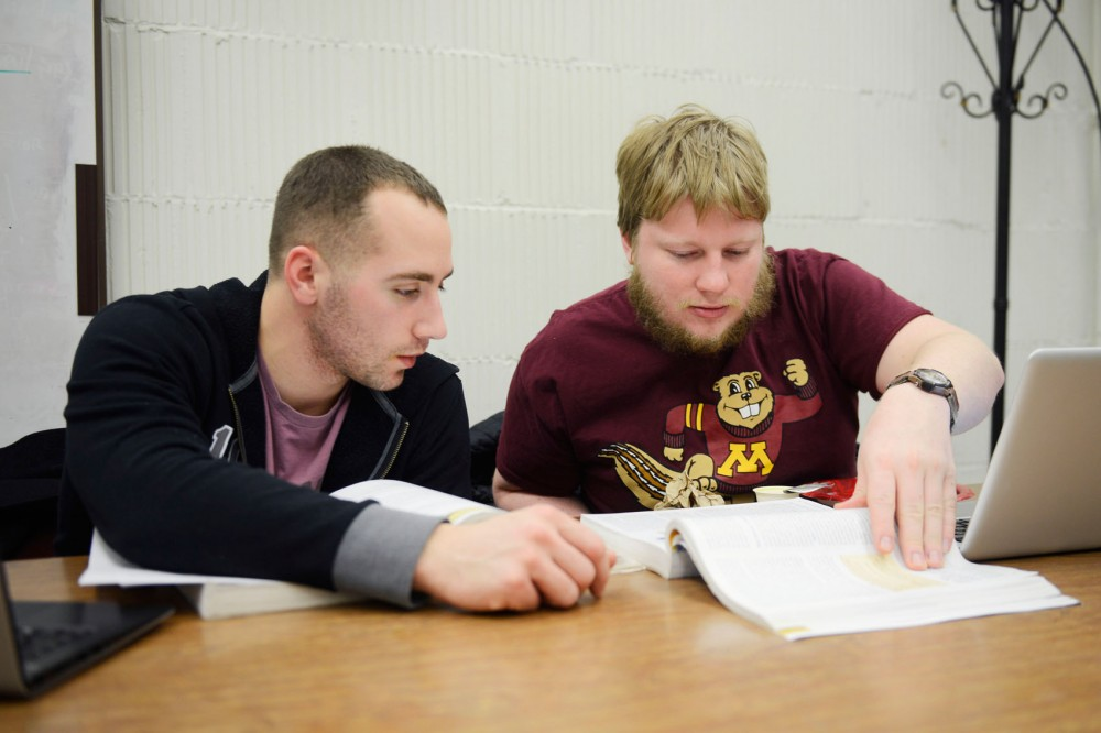 Biology society and environment sophomore Matthew Cohen, left, and fishers and wildlife junior Dan Dewey, right, study at the Veterans Transition Center in Johnston Hall on Friday, March 7, 2014. Both are veterans and go to the VTC to study and hang out with other student veterans.