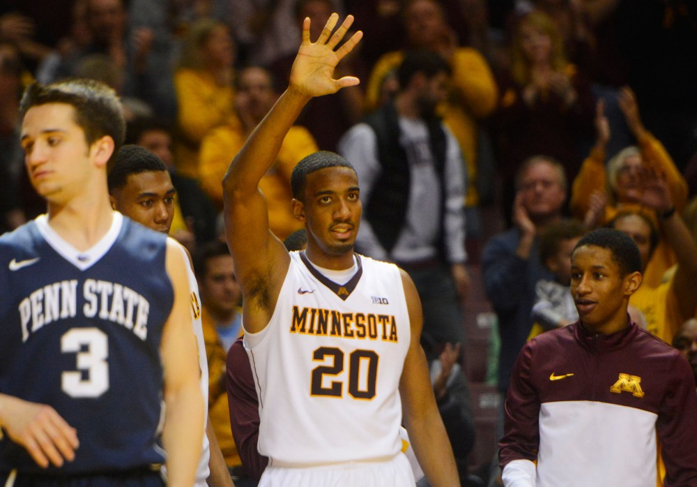 Minnesota guard Austin Hollins waves goodbye after finishing his last home game on Sunday, March 9, 2014 against Penn State.