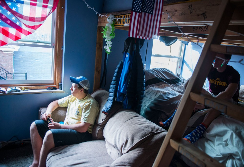 Sigma Chi fraternity members David Lofstuen and Garrett Hulse relax in their room in the main house of the fraternity on Sunday.