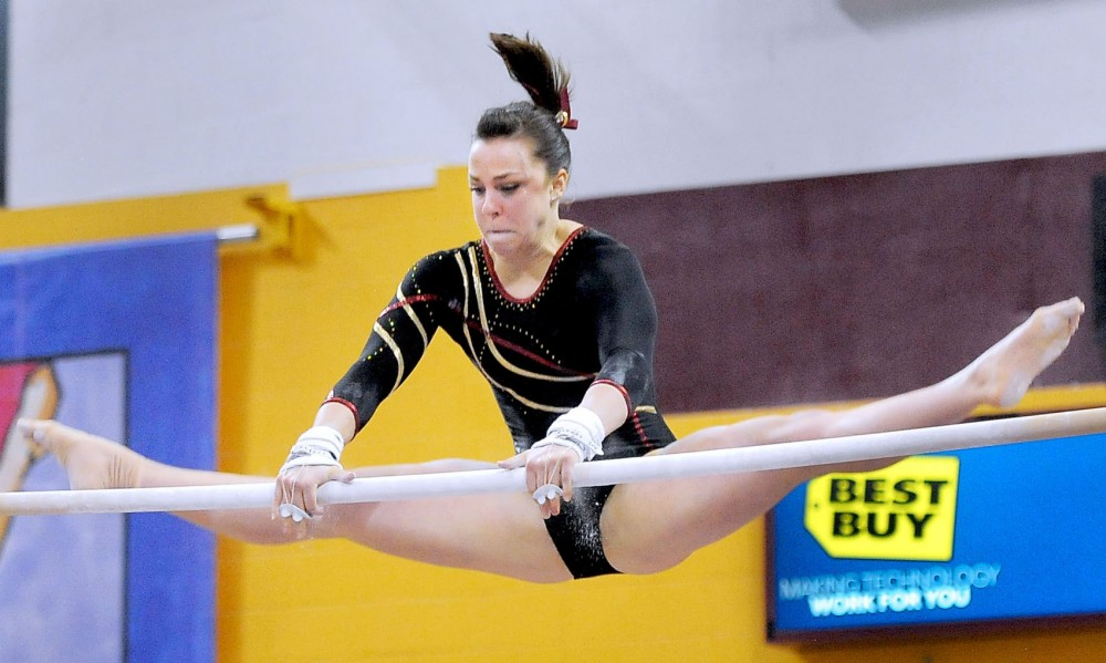 Minnesotas Kayla Slechta competes on bars March 9, 2013, in a quad meet at the Sports Pavilion.