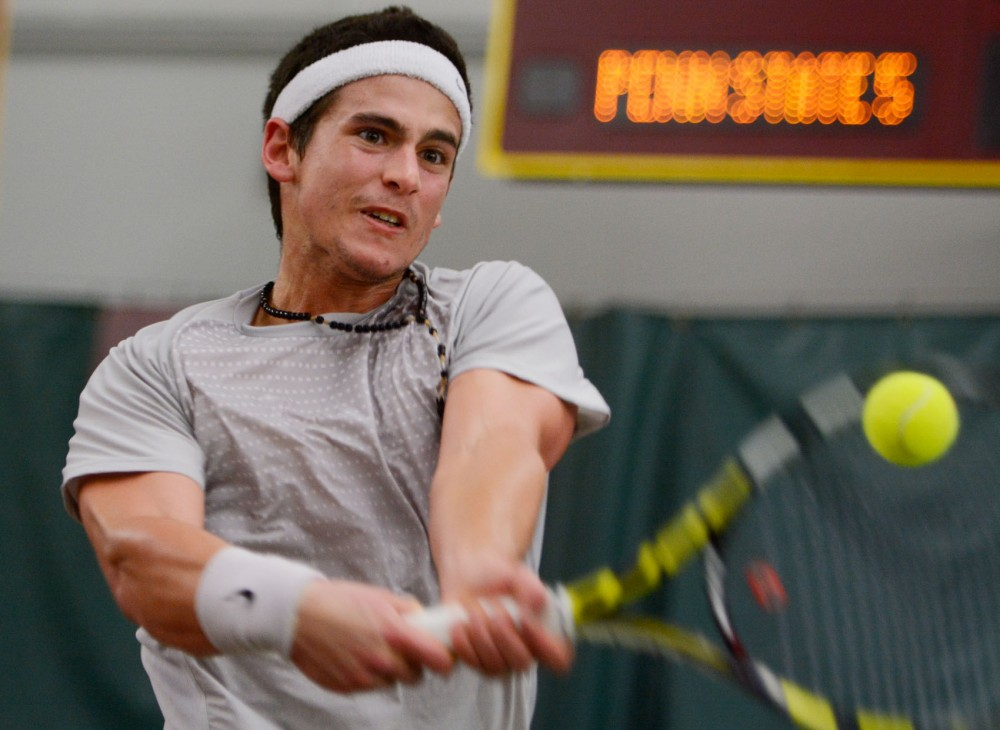 Minnesota freshman Franz Sydow plays a singles match against Penn State at Baseline Tennis Center on Sunday.