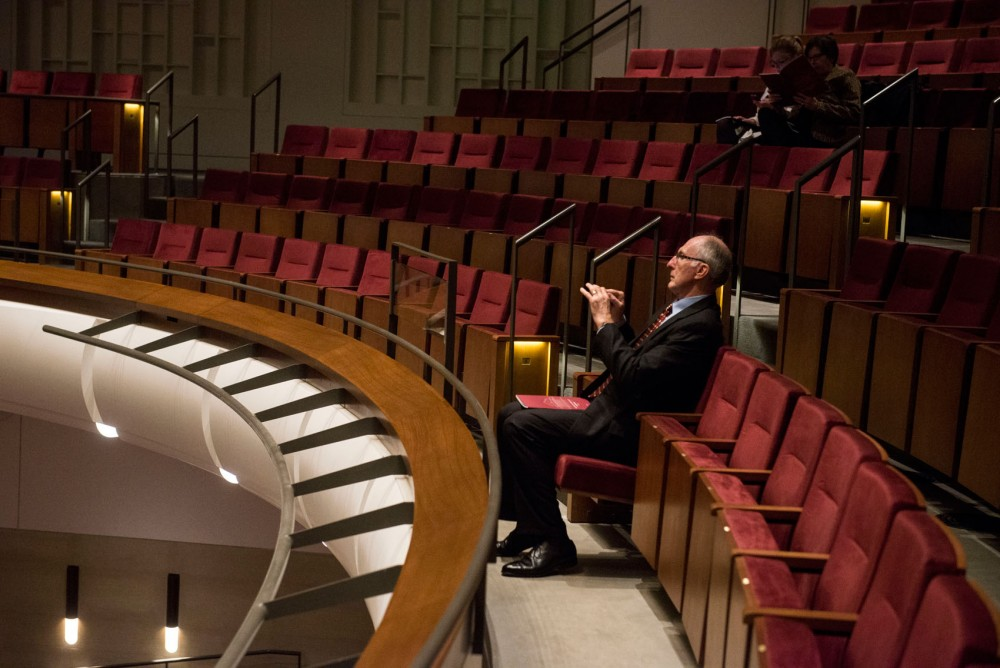 University of Minnesota alumni Tom Gross takes a photo of  Northrop Auditorium's stage. Gross saw his first orchestral  concert at Northrop Auditorium when he was an undergrad, and also graduated in the building.