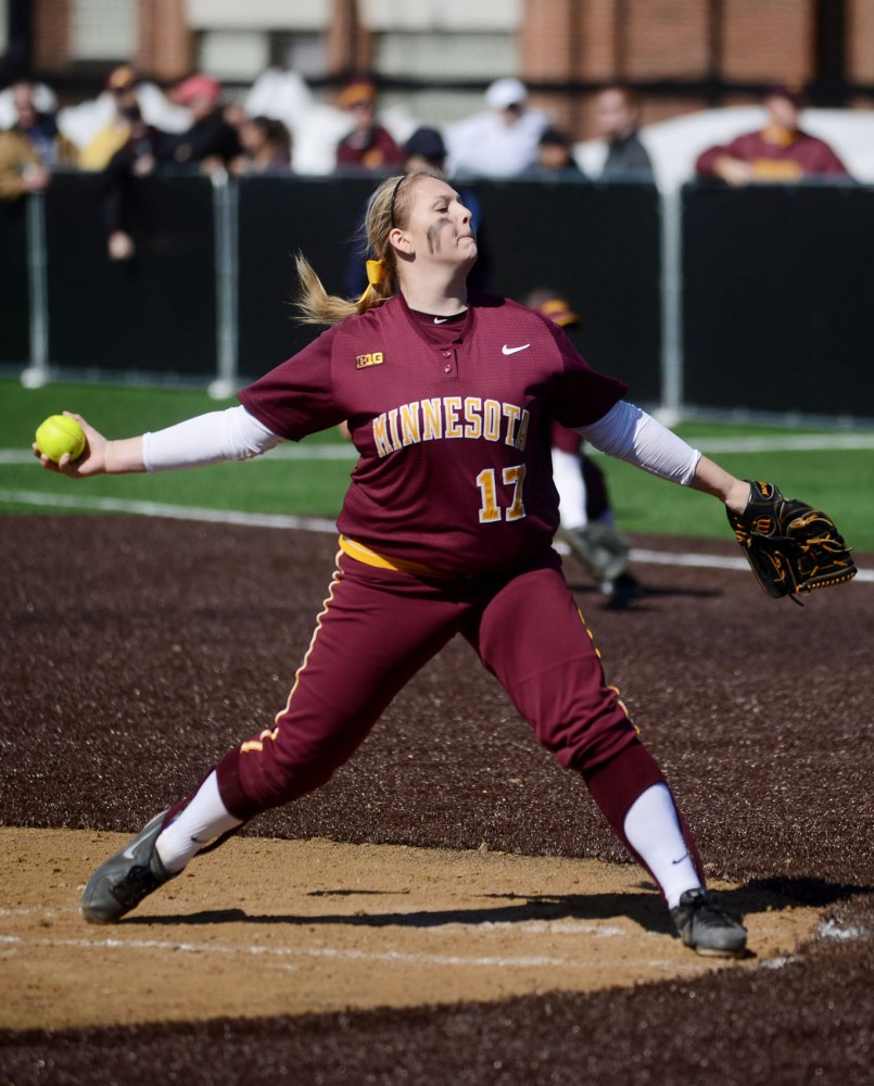 Minnesota's Sara Groenewegen pitches against Illinois on Saturday, March 29, 2014, at St. Thomas University.