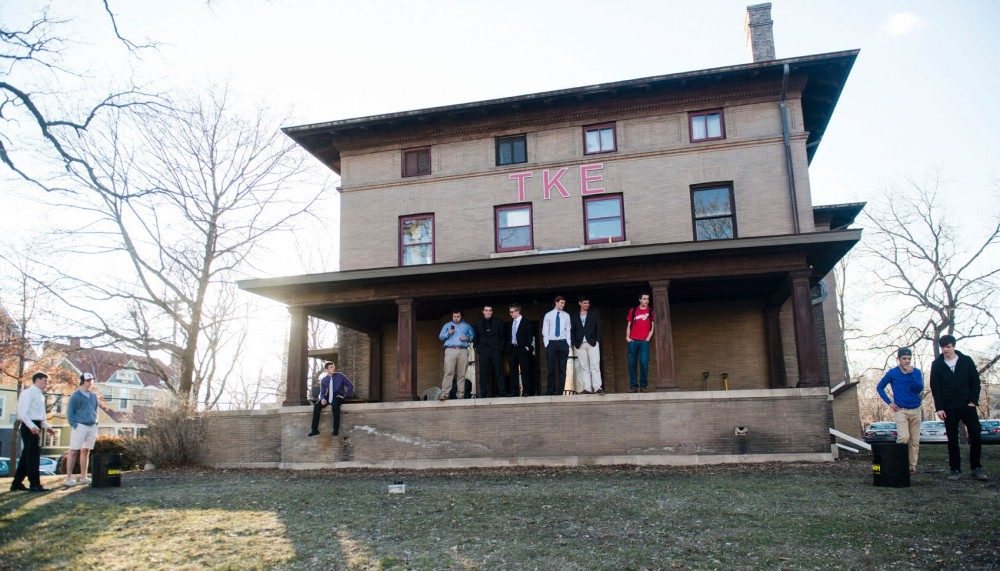 The Tau Kappa Epsilon fraternity members hang out on the lawn of their fraternity house located on Sixth Street SE on Monday, April 7, 2014.