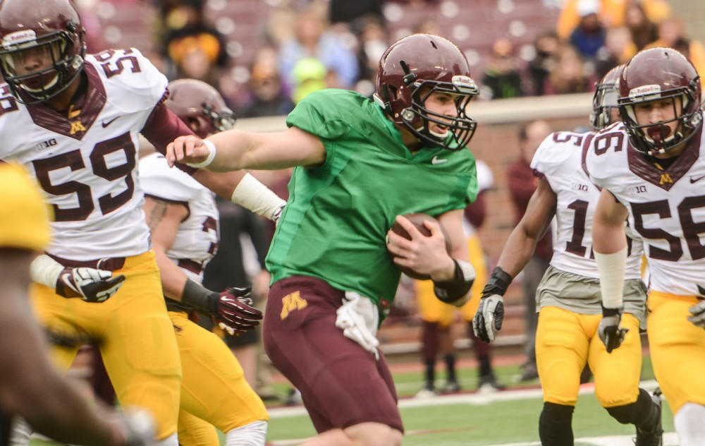 Gophers quarterback Chris Streveler runs with the ball durring the spring football game at TCF Bank Stadium on Saturday.