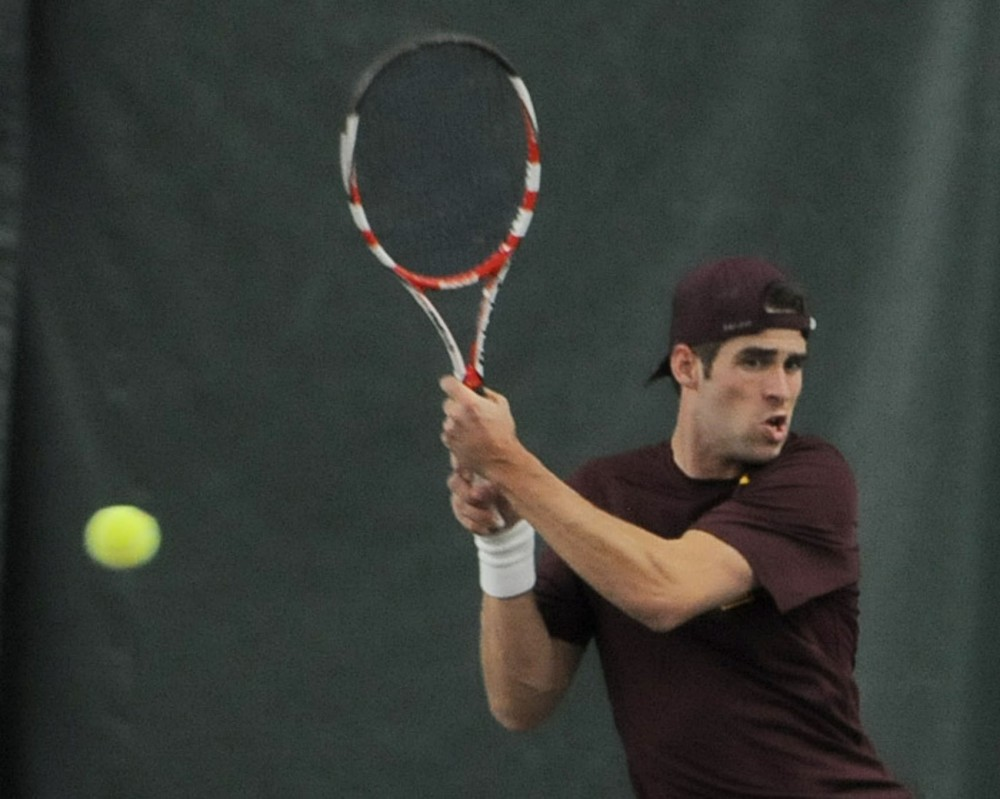 Minnesota sophomore Ruben Weber plays a singles match against Michigan at Baseline Tennis Center on Friday.