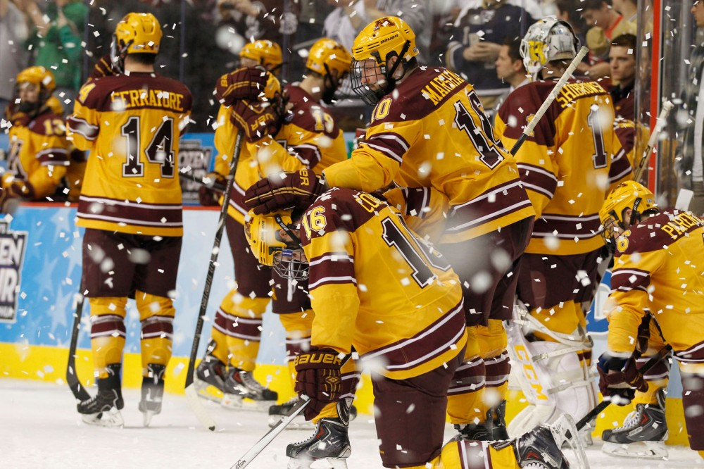 Minnesota's Ben Marshall rests his hand on Nate Condon after the Gophers lost in the NCAA championship 7-4 against Union College on Saturday evening in Philadelphia.