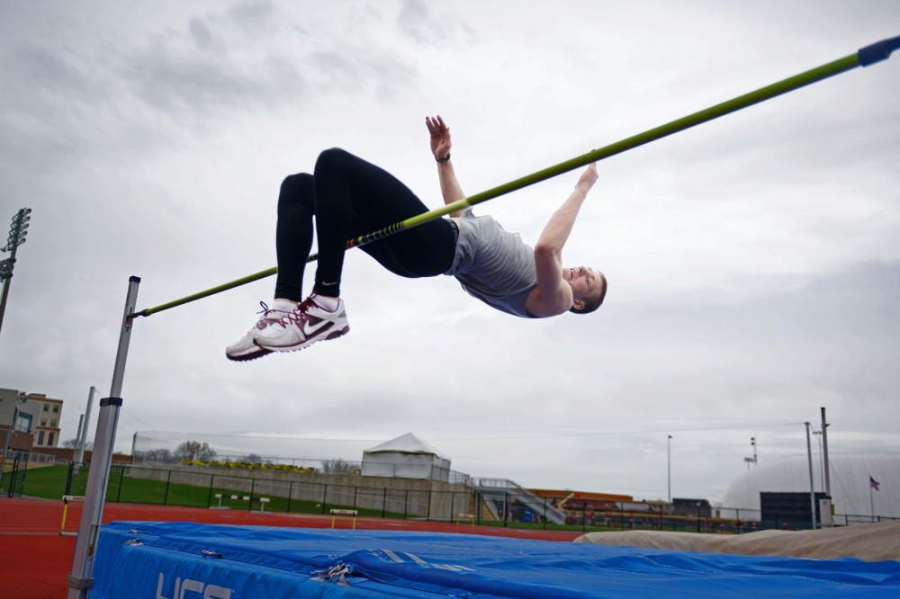 Minnesota high jumper Wally Ellenson practices at Bierman Field on April 30, 2013.