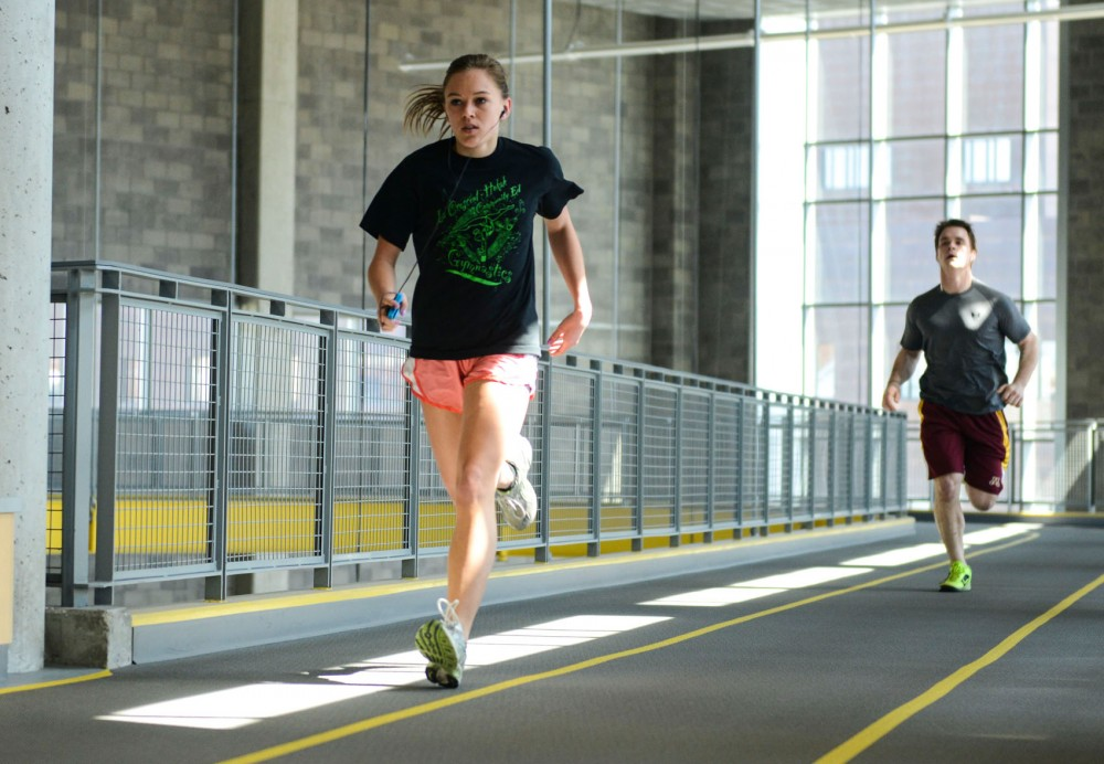 Sophomore Loralee Onstad runs on the track at the University's Recreation and Wellness Center on Tuesday.  New University of Minnesota research shows that cardiovascular exercise in youth helps preserve memory.
