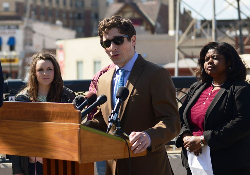 City Council member Jacob Frey speaks to the press Friday in Dinkytown about being safe after Saturday's Gophers men's hockey team's NCAA championship game.