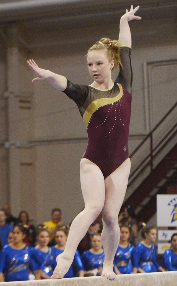 Minnesota's Lindsay Mable executes her balance beam routine at the NCAA regional competition April 5 at the Sports Pavilion. Mable won the all-around competition and qualified for the NCAA individual meet.