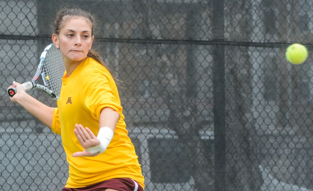 Julia Courter plays against Illinois Friday afternoon at Baseline Tennis Center. Minnesota lost to Illinois 4-3.